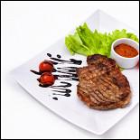 Ресторан Люкс - фотография 1 - Отбивная из свинины с соусом за 265 рублей