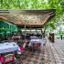 Ресторан Сказка Востока - фотография 7 - Летний дворик вид с крытой веранды.